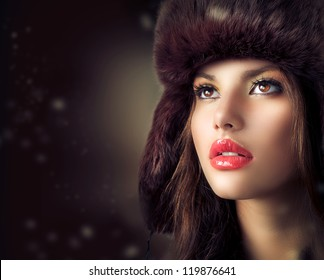 Beauty Fashion Model Girl in a Fur Hat. Beautiful Stylish Woman Portrait.Winter Style Girl.