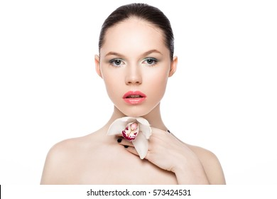 Beauty fashion model holding white orchid at spa on white background