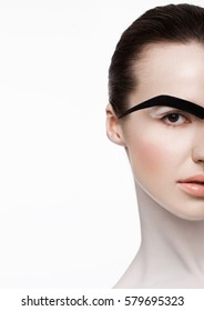 Beauty fashion model white skin creative makeup with fake paper eyebrow half face on white background