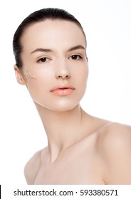 Beauty fashion model woman with liquid foundationon her cheek on white background