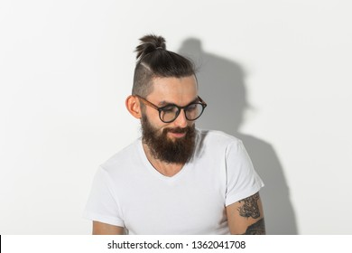Beauty, fashion and people concept - portrait of hipster man with beard over white background
