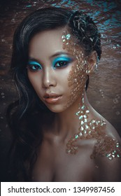 Beauty fashion portrait of beautiful young woman with scales as mermaid