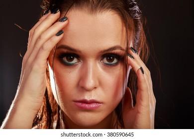 Beauty fashion portrait of a brunette. Portrait of a girl in low key