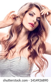 Beauty fashion portrait. Glamor sexy blonde girl with styling hair, fashionable makeup. Beautiful woman with perfect skin, trendy wavy hairstyle. Skincare facial treatment make up concept