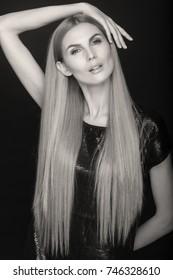 Beauty Fashion Portrait. Hairstyle. Monochrome studio shot.