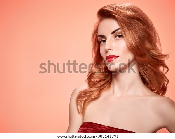 Beauty fashion portrait nude redhead woman, eyelashes, perfect skin, makeup, coral lips. Gorgeous sensual fashionable redhead sexy model girl, shiny wavy hair