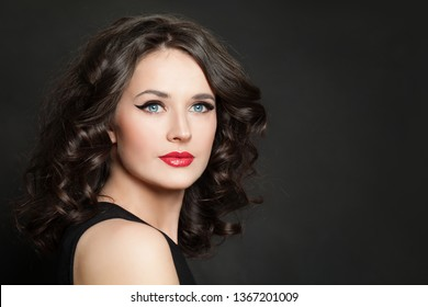 Beauty fashion portrait of pretty woman with makeup and healthy hair on blackbackground