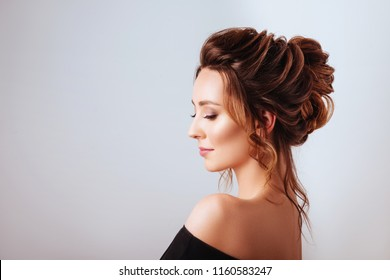 Beauty fashion portrait of young beautiful brunette girl with long black curly hair.
