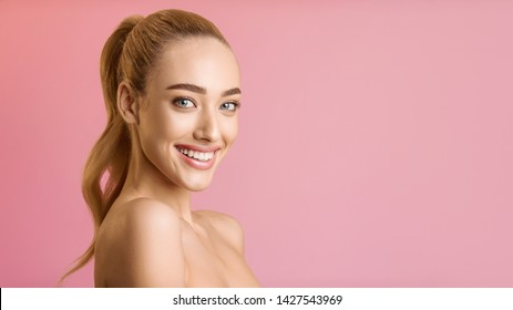 Beauty Fashion Portrait. Young Woman With Ponytail Looking At Camera, Pink Background with Free Space