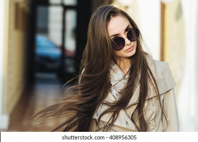 Beauty and fashion, seasonal fashion. Young woman in stylish coat and glasses outdoor.