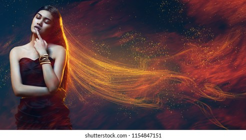 Beauty, fashion. Sensual woman in dress with golden shiny hair in sparks