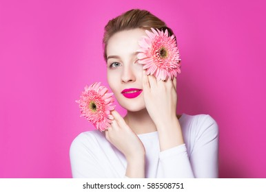 Beauty fashion spring portrait. Beautiful young woman on ping herrera daisy wreath studio portrait. Holiday make-up and perfect skin.