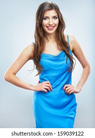 Beauty fashion style isolated portrait of happy young smiling woman. Evening blue dress. Isolated studio background female model.