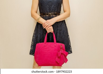 Beauty and fashion. Stylish fashionable woman holding a red bag
