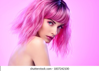 Beauty Fashion woman with Colorful Pink Dyed Hair. Girl with blue eyes, perfect Makeup and Hairstyle. Beautiful smiling model portrait, fashionable pink make up, hair. Skincare concept