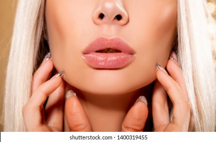 Beauty Fashion woman lips with natural Makeup. shine lipstick. Beauty girl face close up. Closeup mouth Nude Colors lacquered. Sexy lips, Make up. Over golden background. big lips - image