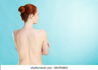 Beauty female figure, body care concept. Attractive red hair naked sensual woman back view. Pertect clean soft skin