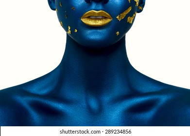 Beauty female Model with blue Skin and gold Lips. Halloween Makeup