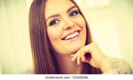 Beauty of feminince concept. Portrait of happy, positive attractive woman with long brunette hair.
