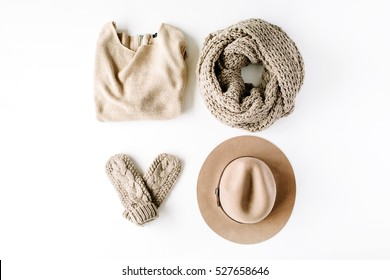 beauty feminine clothes arrangement with hat, mittens, sweater, scarf. flat lay, top view
