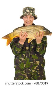 Beauty fisher woman holding big carp isolated on white background