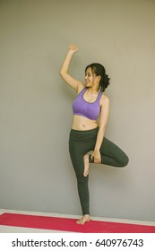 Beauty fitness Young woman meditates while practicing yoga. Freedom concept. Calmness and relax, woman happiness.Yoga concept.