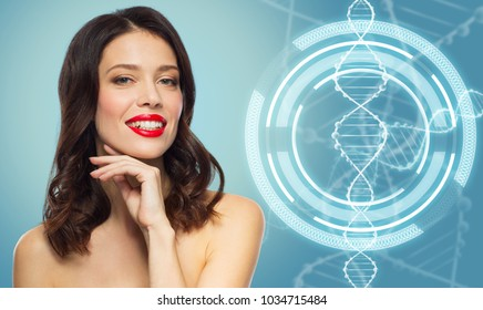 beauty, genetics and people concept - happy smiling young woman with red lipstick posing over blue background and dna molecule hologram