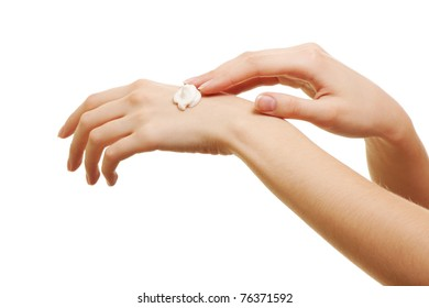 beauty girl applying some white lotion on her hand