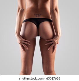 beauty girl back in pants string isolated over grey background