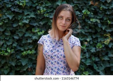 beauty  girl in dress walk in the park