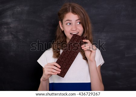 Beauty Girl Eating Chocolate Beautiful Surprised Stock Photo Edit