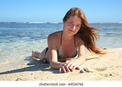 beauty girl enjoying the sand beach on nice day
