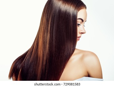 Beauty Girl face Portrait. Beautiful Spa model Woman with Perfect Healthy Hair Smooth. Brunette female looking at camera and smiling. Youth and Skin Care Concept