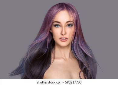 Beauty girl with flying long colored hair. Beautiful woman with smooth straight shiny hair. Colorful hair different color