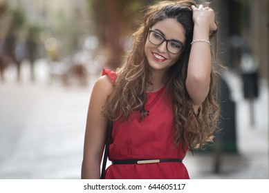 beauty girl with glasses smiling in street