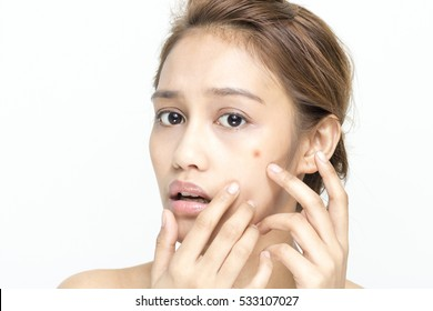 beauty girl of half latina and half asian who checks her skin, skin care, acne treatment