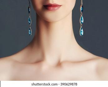 beauty girl in jewelry. Young woman in earrings.Long neck