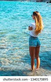 beauty girl with long hair on the seashore