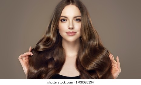 Beauty girl with long  and   shiny wavy hair .  Beautiful   woman model with curly hairstyle . - Shutterstock ID 1708028134