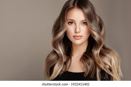 Beauty  girl with long  and   shiny wavy  Hair ,coloring and toning, shatush and balayash .  Beautiful   woman model with curly hairstyle . - Shutterstock ID 1922411402