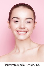 Beauty girl natural makeup spa skin care and gorgeous smile on pink background