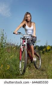 beauty girl on bike in summer day.