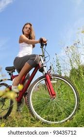 beauty girl on bike in summer day