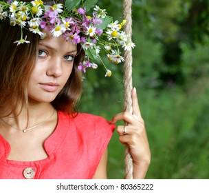 beauty girl on swing outdoors