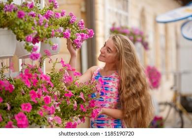 Beauty Girl Outdoors enjoying nature. Beautiful Teenage Model girl with long hair , Sun Light. Glow Sun. Free Happy Woman. Toned in warm colors