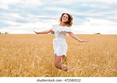 Beauty Girl Outdoors enjoying nature on the Field