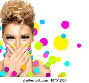 Beauty Girl Portrait with Colorful Makeup, Nail polish and Accessories. Colourful Studio Shot of Funny Woman. Vivid Colors. Colourful Manicure and fashion Hairstyle. Rainbow Colors. Beautiful lady