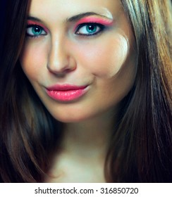 Beauty Girl Portrait with Colorful Makeup, Nail polish and ring Accessories. Colourful eyeshadows make-up.
