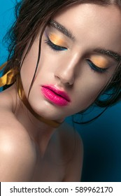 Beauty Girl Portrait with Vivid Makeup. Fashion Woman portrait close up on yellow background. Bright Colors. Manicure Make up. Smoky eyes, long eyelashes. Rainbow Colors. Retouched shot