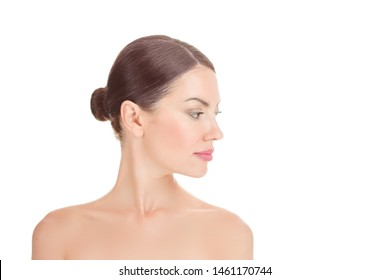 Beauty girl posing. Close up head shot beautiful woman looking to the side in profile showing clean skin fresh face, head and shoulders portrait, body isolated on white background with copy space